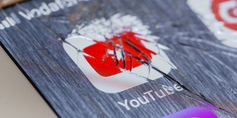 youtube logo under broken screen