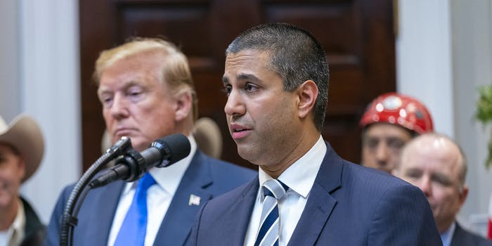 Ajit Pai standing next to President Donald Trump. Pai said the FCC won't take up Trump's Section 230 executive order.