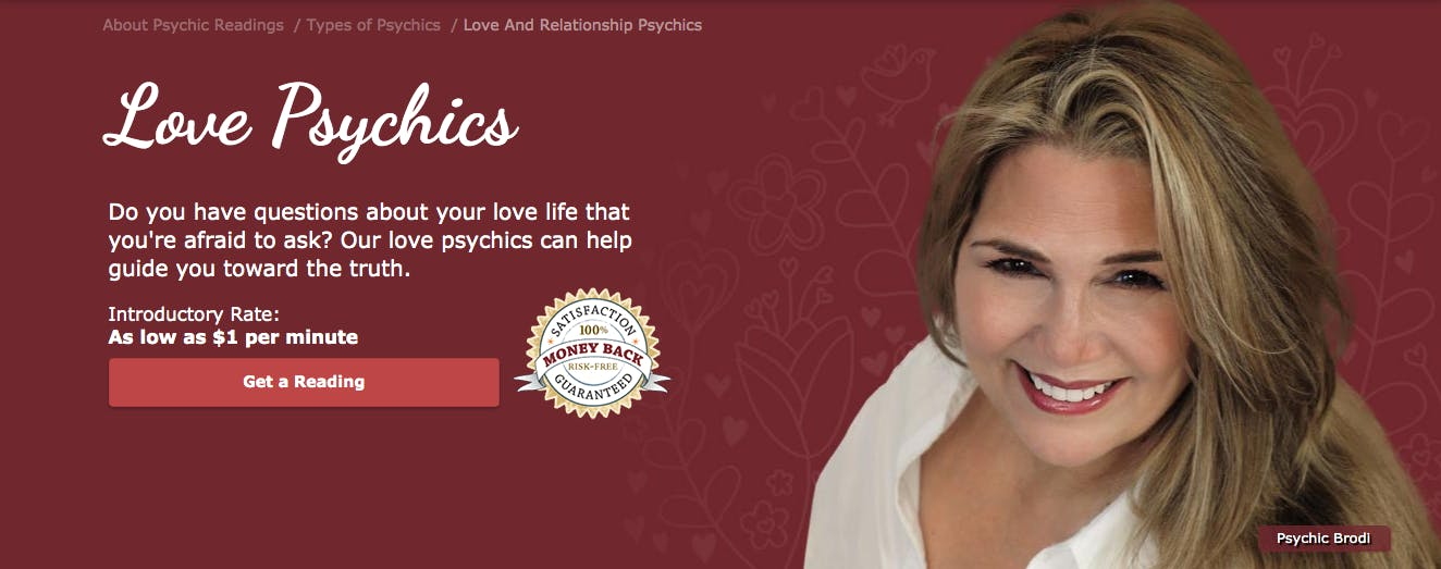 A banner for love psychics features a smiling reader