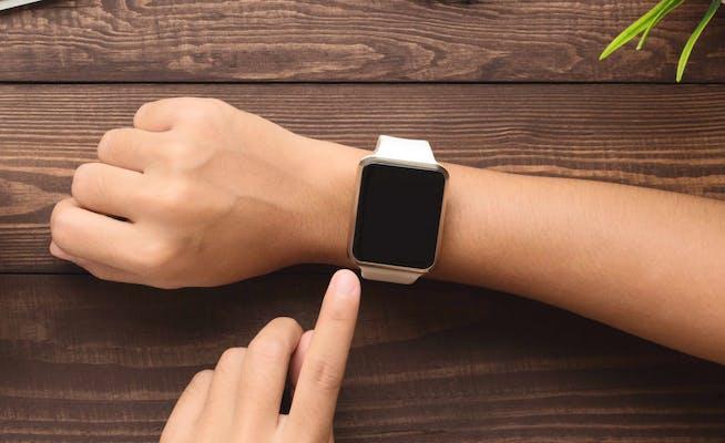 apple watch gps tracker woman using apple watch on wrist