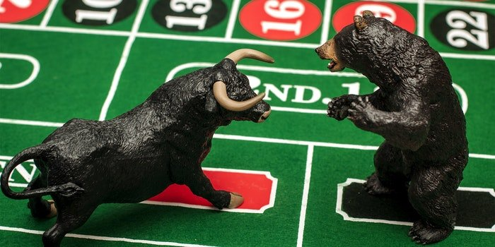 Bull and bear figurines on roulette table