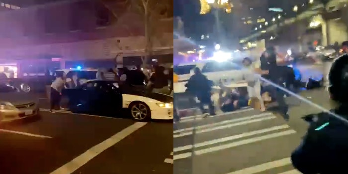 A police officer running into a crowd of people