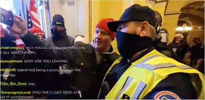 Cop poses for a selfie with Trump supporters on capitol hill during riots