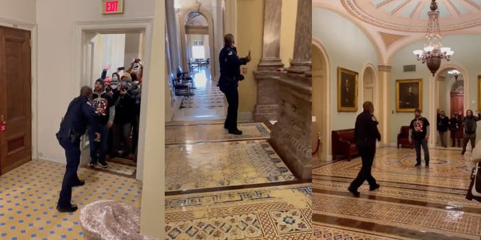 A police officer in the Capitol facing off against rioters