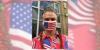 man wearing US flag mask with US flag shirt and a lei