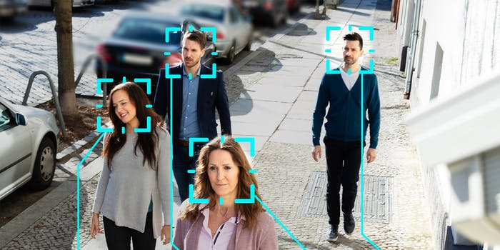 People on street with facial recognition overlays on their heads