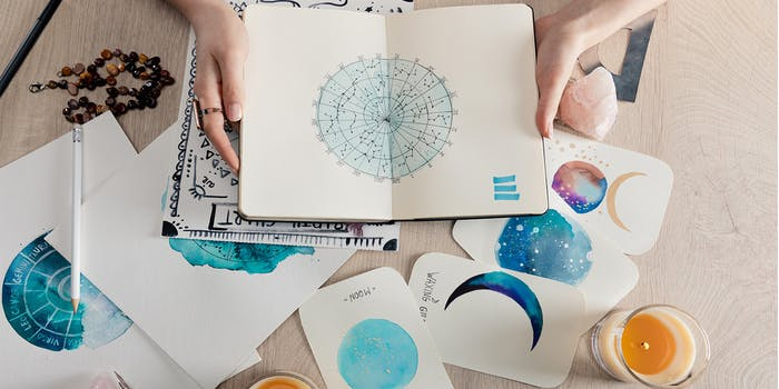 Hand drawn birth chart surrounded by tarot cards