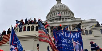 capitol being ransacked by qanon believers