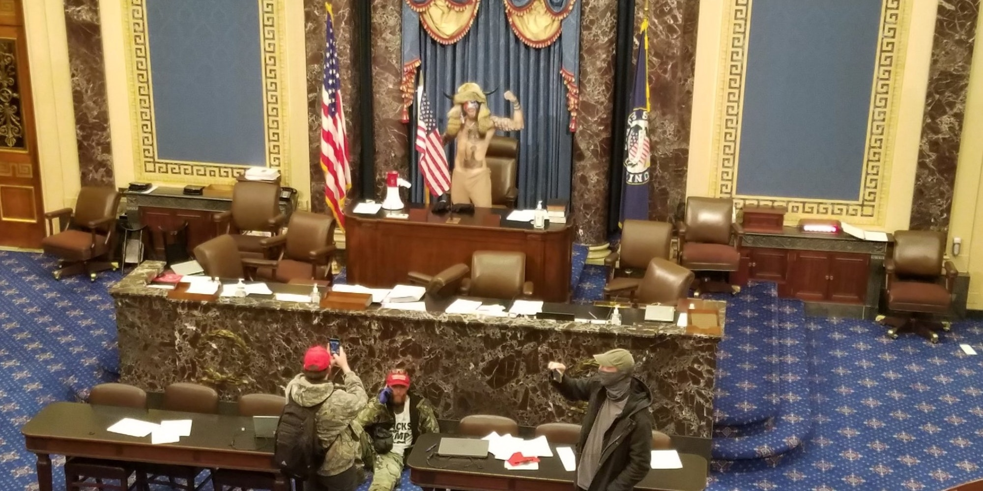 qanon supporter stands in the house of representatives