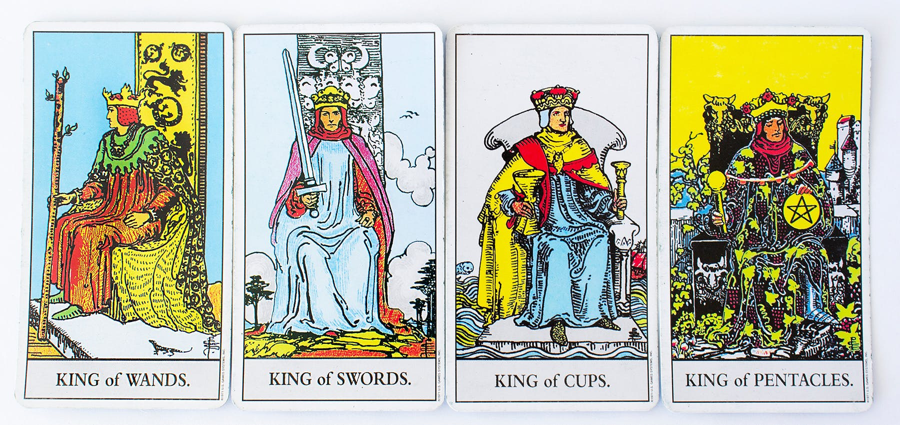 Examples of the Minor Arcana cards, includes an image of the King of wands, King of swords, king of cups, and the king of pentacles.