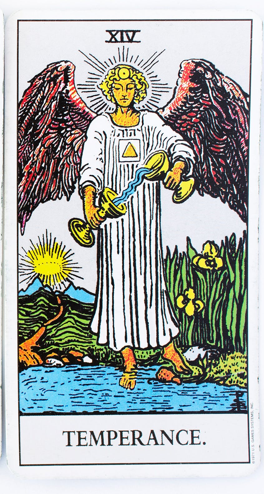 temperance card from the rider-waite deck. image of an angle pouring water from one cup to another.