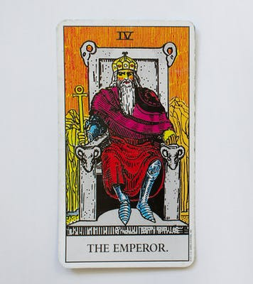 The emperor card. Features a man sitting in a throne wearing a red cape and holding a scepter.