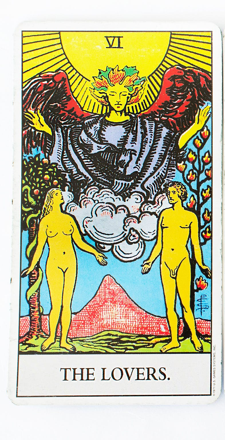 The Lovers tarot card. Features an image of two people naked standing next to each other reaching out as if to hold hands.
