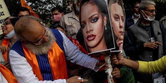 People prepare to burn an effigy of Rihanna and Greta Thunberg
