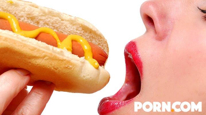 Woman eating a hotdog for a porn.com ad