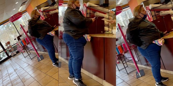 Woman standing at Dunkin Donuts counter