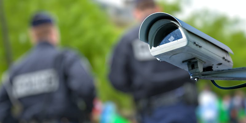 Police and a facial recognition camera.
