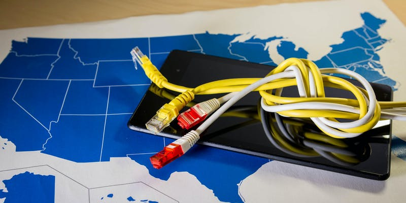 knotted net cable over a smartphone and US map.