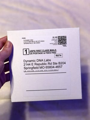Dynamic DNA Labs' pre-paid cardboard mailer.