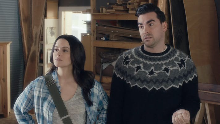 An Image of Daniel Levy in his star sweater on the TV series Schitt's Creek.