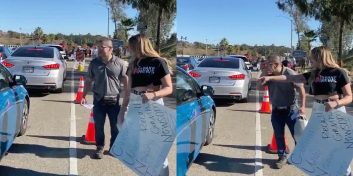 Anti-vaxxers heckle drivers waiting to get COVID vaccine