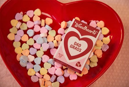 Dad Grass preroll limited edition valentine's day box in a bowl of sweethearts