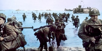 US soldiers enter the beach from the water at The Battle of Normandy, 1944,