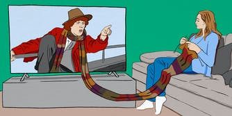 The Doctor pointing from television screen, his scarf extending outside the television onto the lap of a woman who is knitting it while watching the show.