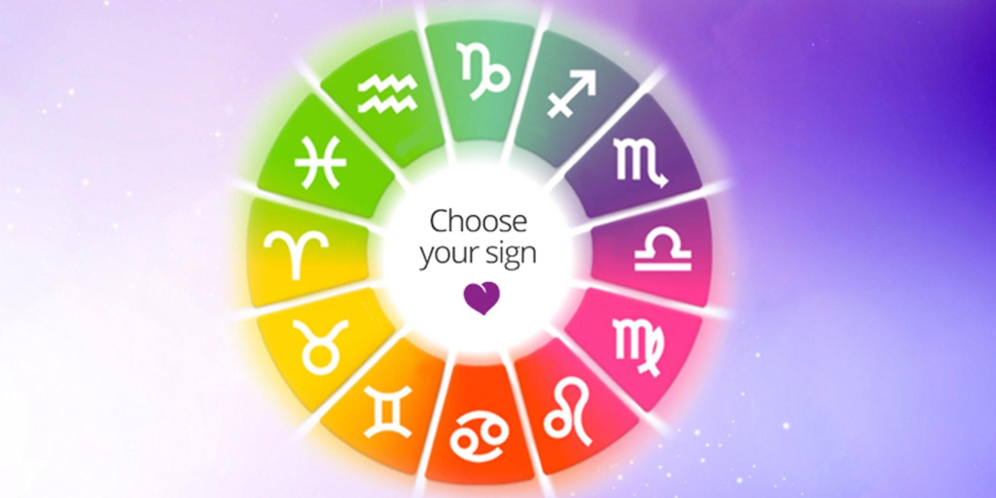 Rainbow zodiac wheel on a purple galaxy background