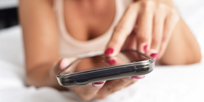 closeup of woman swiping on her phone.