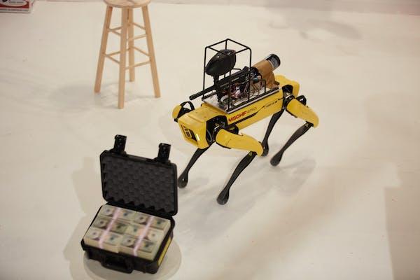 A Spot robot next to an art piece