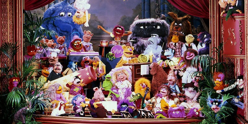 a group of muppets on stage for the muppet show