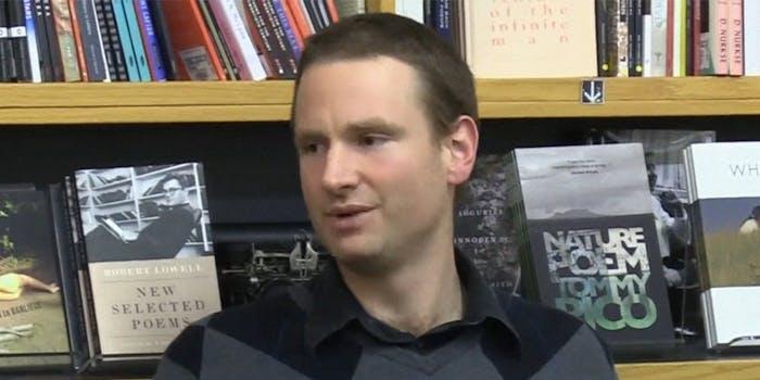 Alexander Reid Ross in front of a bookshelf