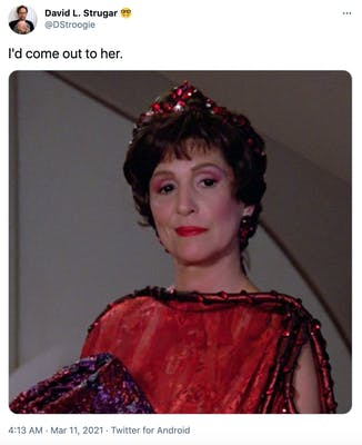 """""""I'd come out to her."""" Majel Barret, an older white woman with dark hair in a red sequinned dress"""