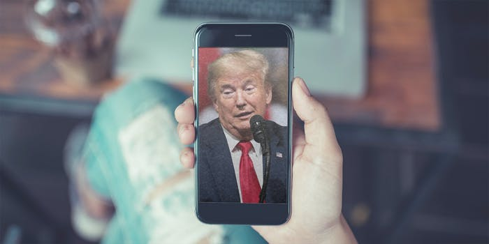 The face of former President Donald Trump on a phone like it would show up when a social media app launches.