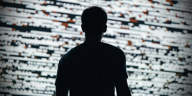 A man in front of digital noise.
