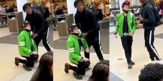 man dressed like ben 10 on one knee and then being helped up