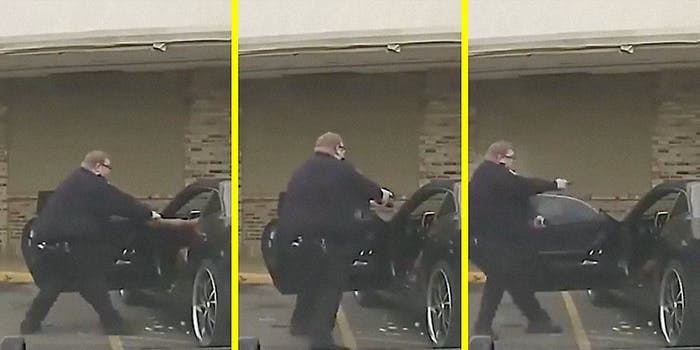 A cop pulls his gun on a person in a car.