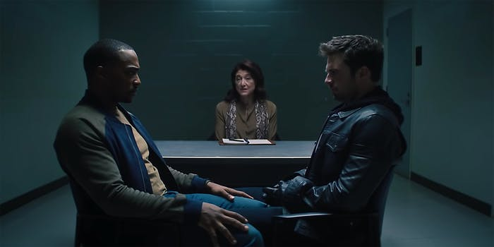 Samuel Thomas Wilson and Bucky Barnes from The Falcon and Winter Soldier stare at each other with a therapist in the background.