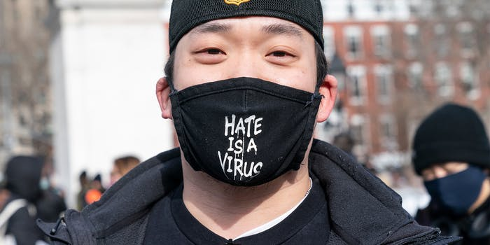 """man wearing """"hate is a virus"""" facemask at Washington Square Park rally in support Asian community, against hate crime and white nationalism"""