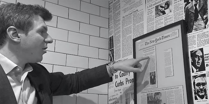 James O'Keefe points at a framed newspaper article.