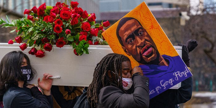 Cortez Rice, nephew of George Floyd, carries an empty casket through downtown Minneapolis.