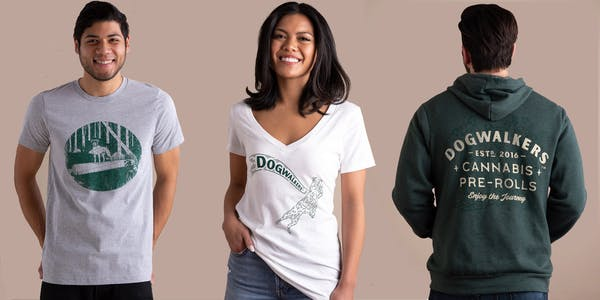 dogwalkers t-shirts with abstract dogs and joints printed on them and a green hoodie with the dogwalkers' logo on a tan background