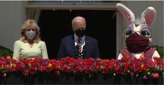 The Bidens stand next to a masked up Easter Bunny