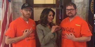 Janice McGeachin with two prisoners making KKK gang signs.