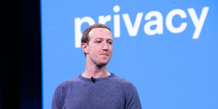 Facebook CEO Mark Zuckerberg talking on a stage in 2019 with the word 'privacy' displaying behind him.