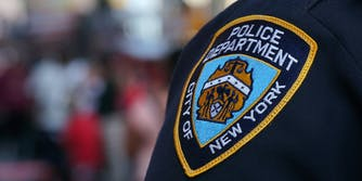 A NYPD badge on the shoulder of a police officer.