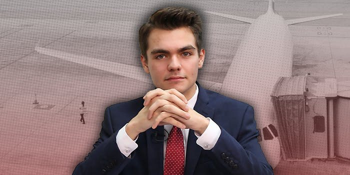 Nick Fuentes in front of an airplane.