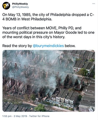 """""""On May 13, 1985, the city of Philadelphia dropped a C-4 BOMB in West Philadelphia.   Years of conflict between MOVE, Philly PD, and mounting political pressure on Mayor Goode led to one of the worst days in this city's history.   Read the story by  @burymeindickies  below."""" aerial photograph of burned out buildings, still smoking"""