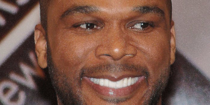 Tyler Perry smiling and looking off camera.